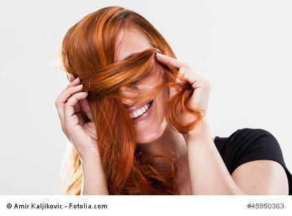 Junge Frau mit geplegten Haaren